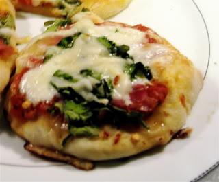 Mini Pizzas with Prosciutto and Greens