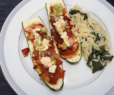 Mediterranean Stuffed Zucchini with Feta-Pepper Sauce