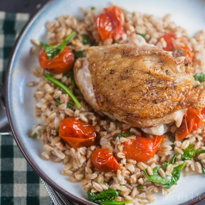 Chicken Thighs with Farro and Burst Tomatoes