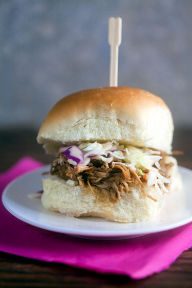 Easy pulled jerk chicken sandwiches topped with citrus slaw and a fun ...