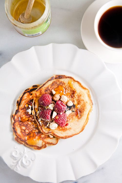 Raspberry Oatmeal Pancakes with Hazelnuts // @HealthyDelish
