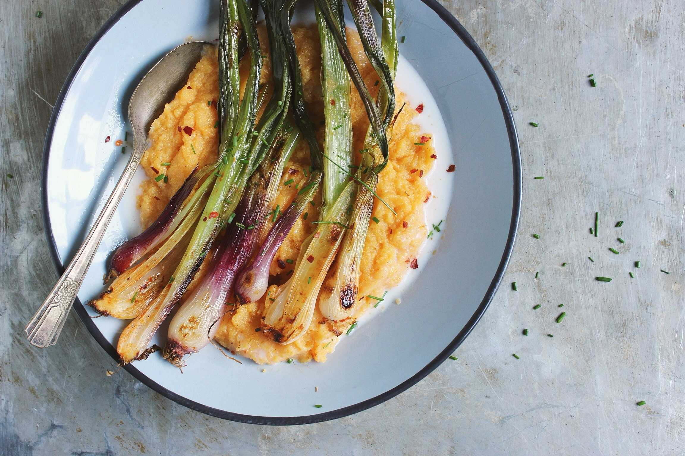 Red Curry Roasted Spring Onions with Creamy Polenta. Photo by Sherrie of With Food + Love.
