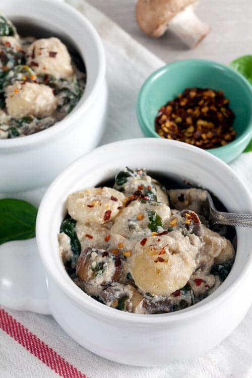 Baked Gnocchi in Tofu Cream Sauce with Spinach and Mushrooms | @HealthyDelish