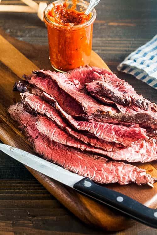 Sliced hanger steak on a cutting board