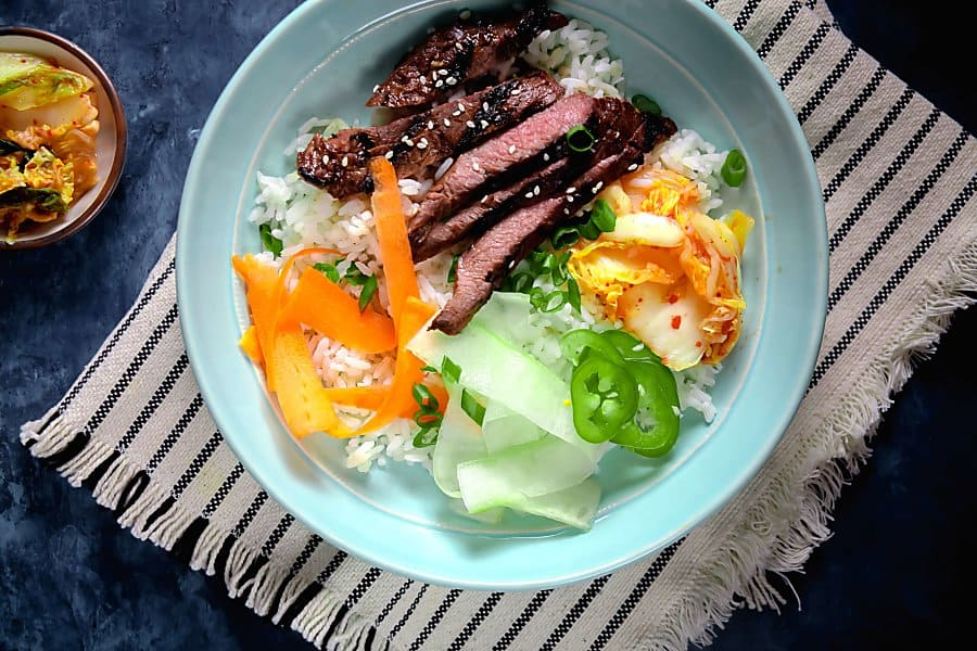 Korean Barbecue Steak Bowls on Blue Plate