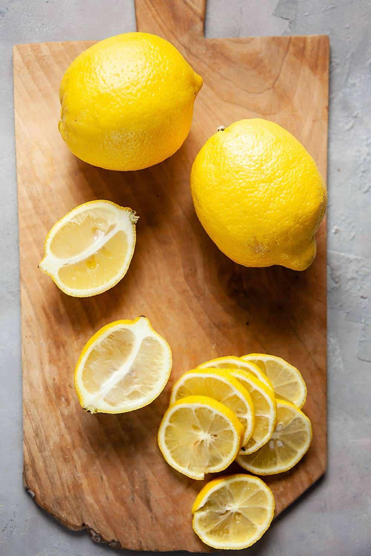 Sliced lemons on cutting board