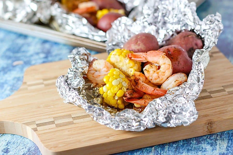 Savor the lazy days of summer with these easy Old Bay shrimp foil packs on the grill. They're ready in under 20 minutes, and cleanup is a breeze!