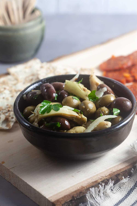 Marinated Artichoke and Olive Appetizer Recipe in a dark bowl