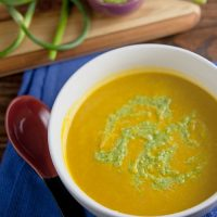 Chilled Carrot Soup with Scape-Pistachio Pesto