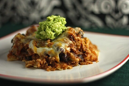 portion of taco bake topped with guacamole on a plate
