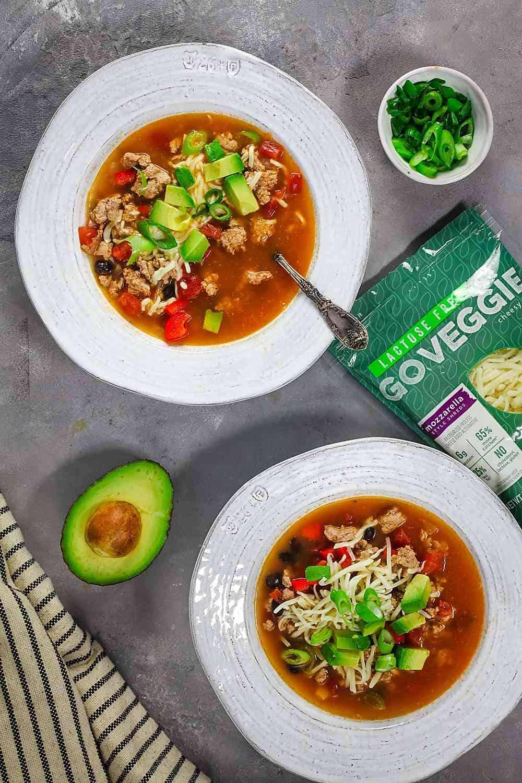two bowls of enchilada soup with homemade enchilada sauce and go veggie mozzarella