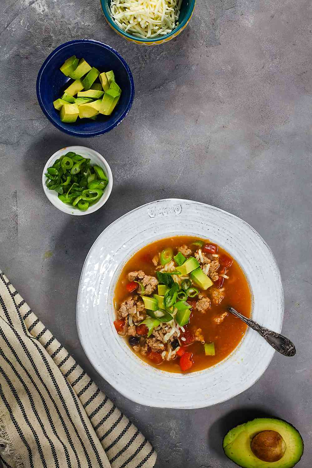 Turkey enchilada soup with various toppings