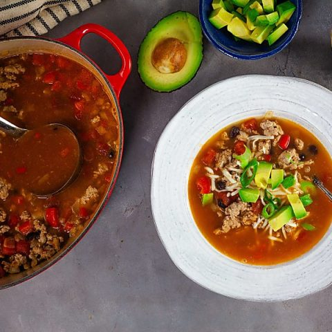 enchilada soup with avocado and green onions
