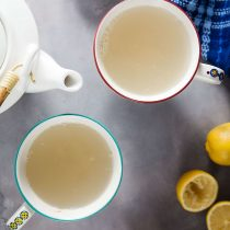two cup of ginger lemon tea and a teapot