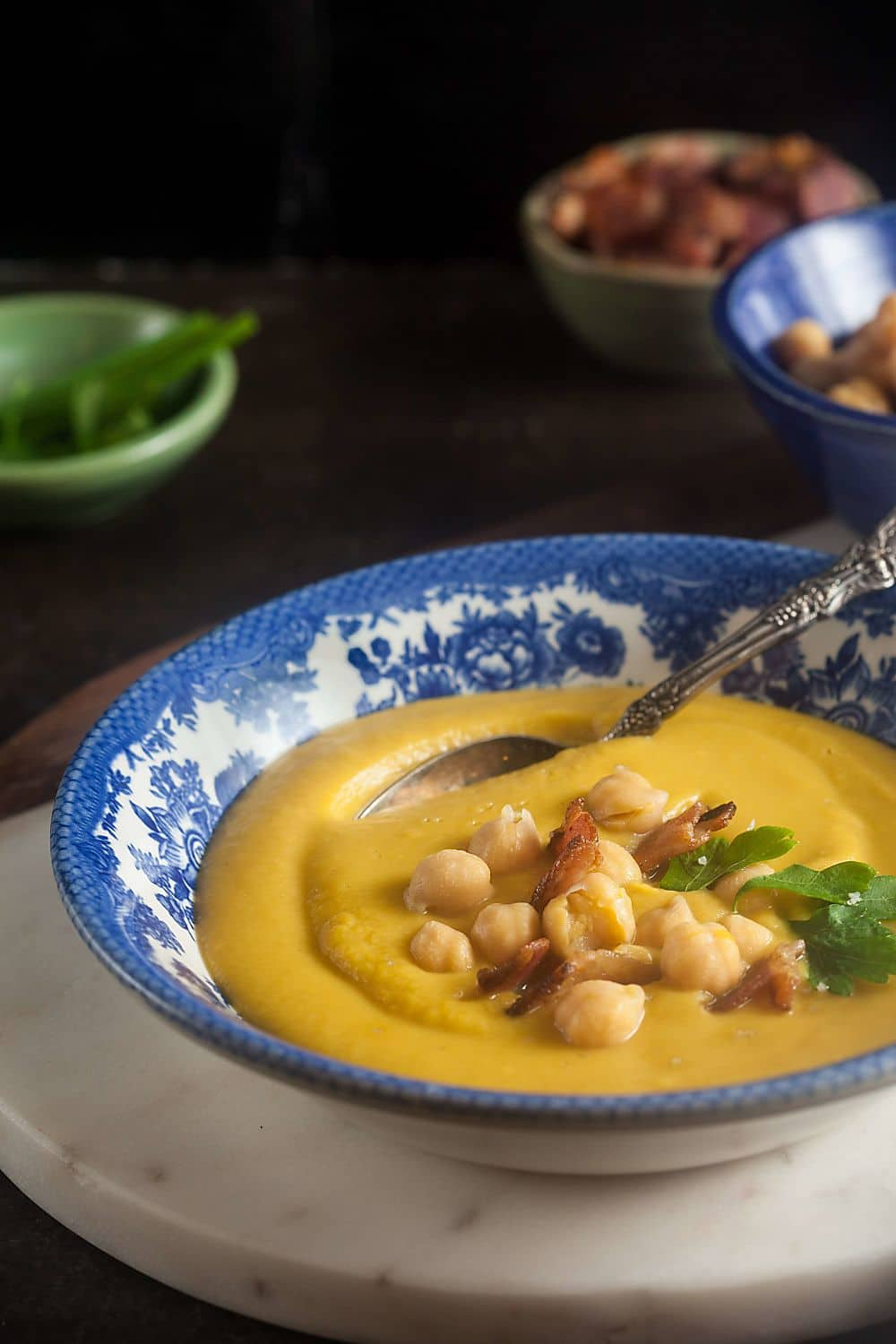 Creamy Chickpea Soup with Bacon in blue bowl