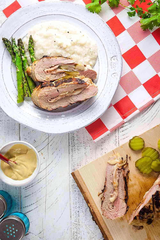 Sliced Cubano Stuffed Pork Loin on a picnic table
