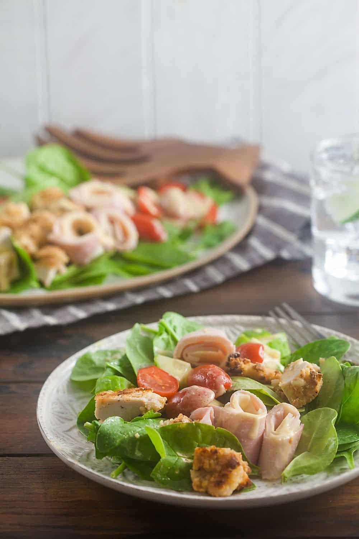 two plates of chicken cordon bleu salad