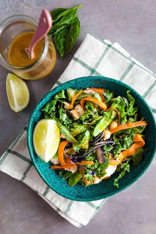 Thai chicken salad in a teal bowl