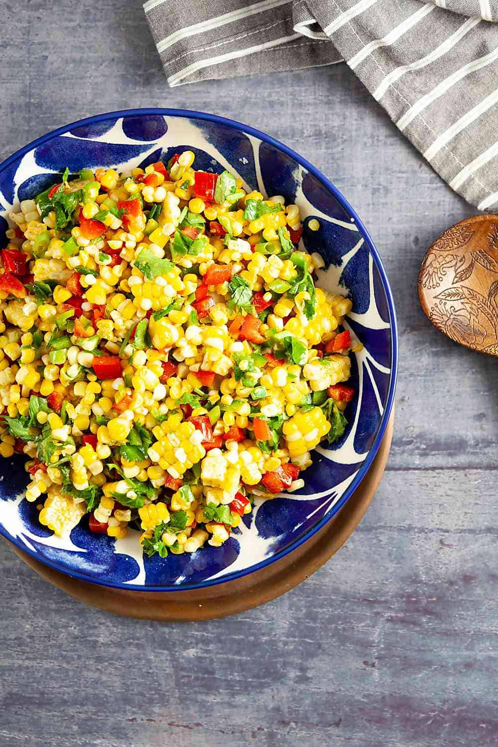Bowl of Corn Salad with a serving spoon and a napkin