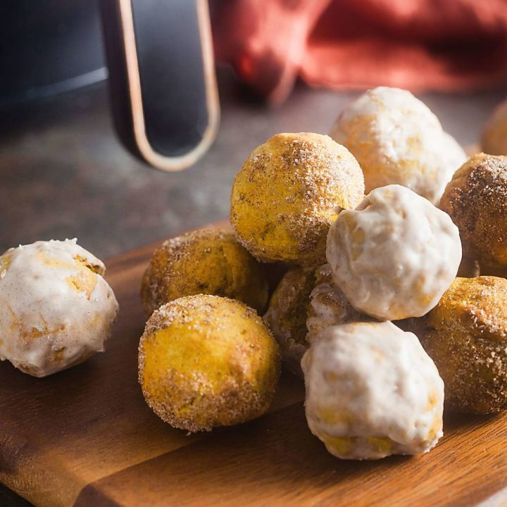 air fried pumpkin spice donut holes on a wooden board