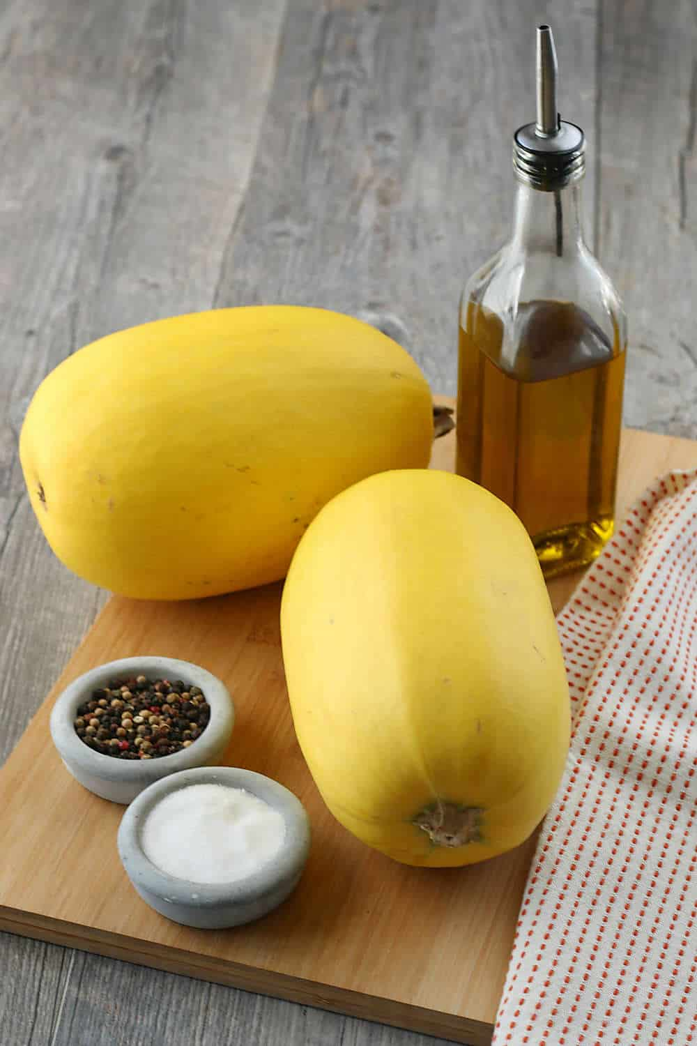 The image shows all the ingredients needed for you to learn how long to cook baked spaghetti squash before we begin the recipe.
