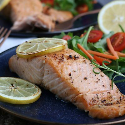 Perfect salmon fillets are easy to make - just pull out your air fryer! The healthy recipe is seasoned simply with lemon and garlic so you can enjoy the salmon plain or as part of other recipes. This method of cooking salmon is practically foolproof - you'll never want to cook it in a pan again!