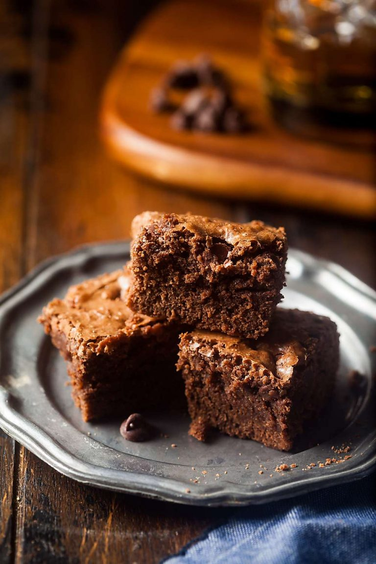 small plate stacked with fudgy brownies
