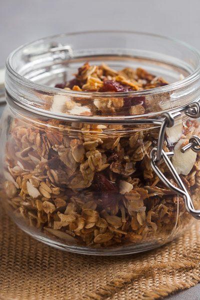 glass jar of granola on a piece of burlap