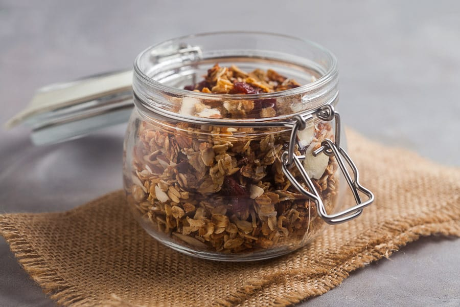 glass jar of granola on a piece of burlap