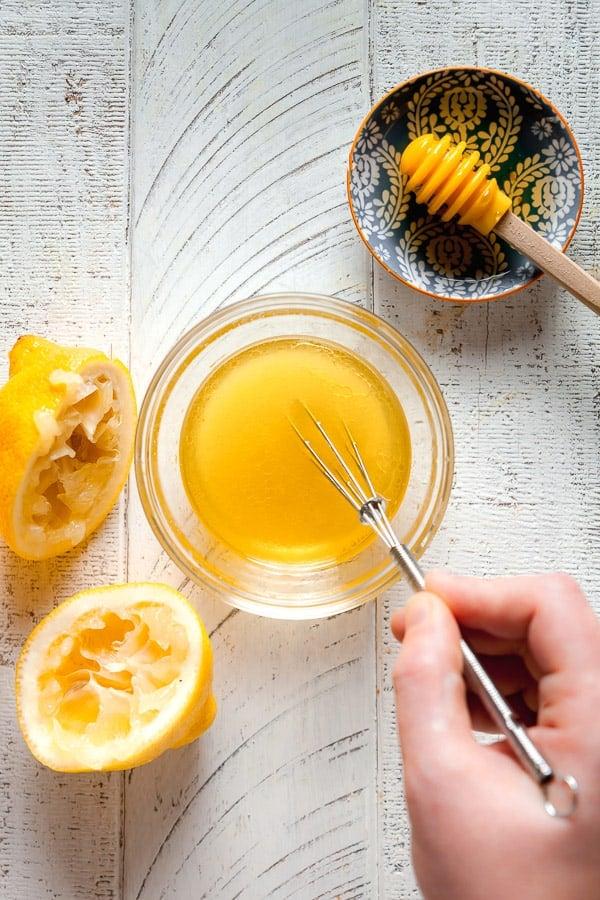 overhead view whisking together lemon vinaigrette