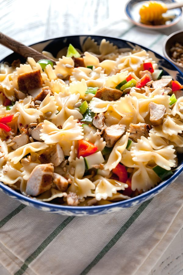 A big bowl of pasta salad with chicken