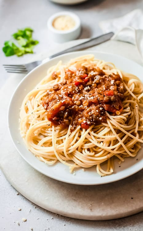 Side view of plated spaghetti with sauce, ready to eat