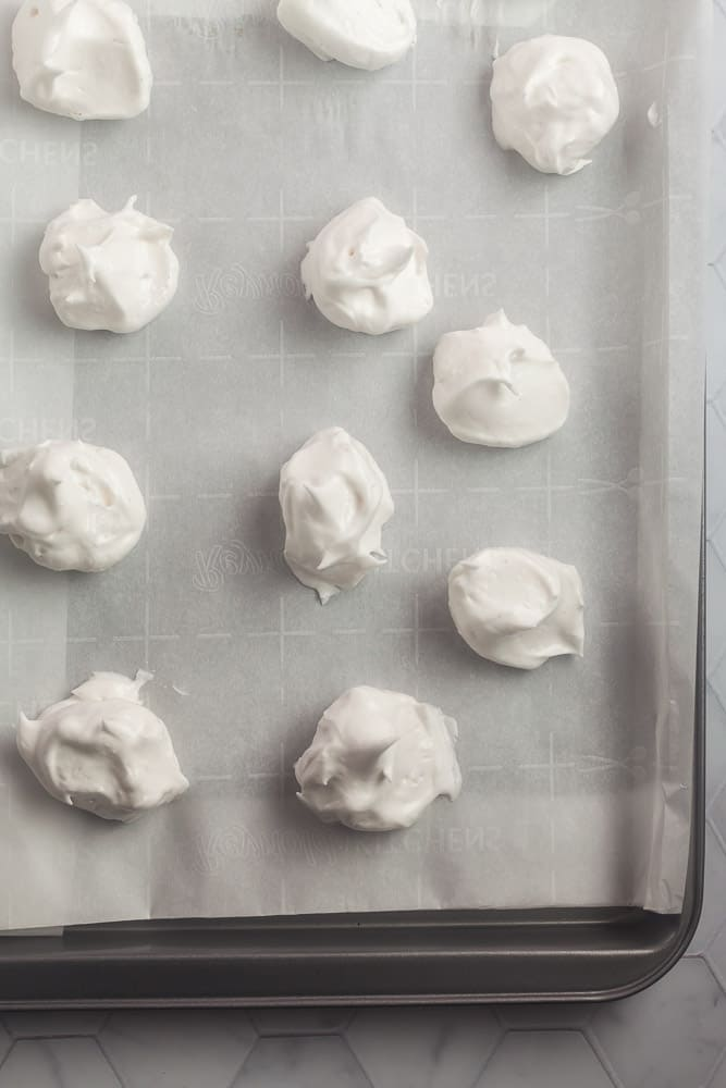 fluffy aquafaba meringue on a baking sheet