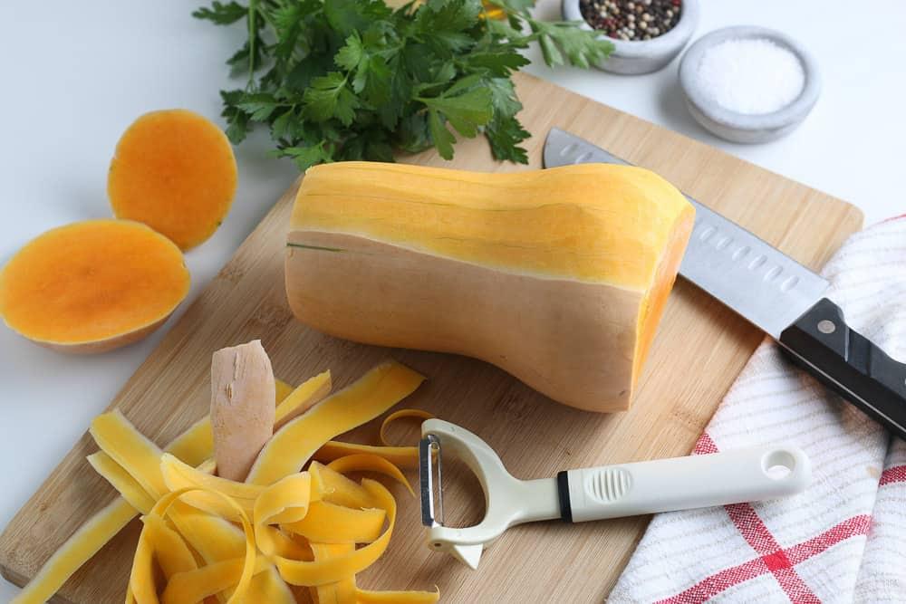 peeling a butternut squash so it's easier to cut