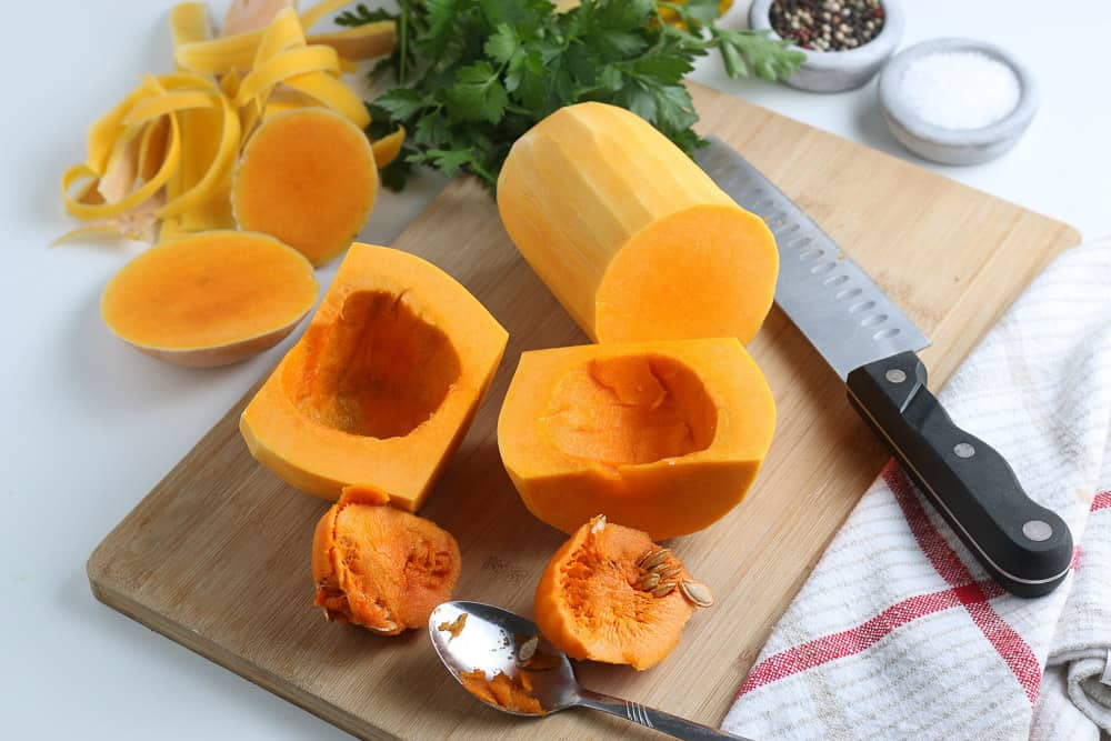 cut the squash into quarters and coop out the seeds