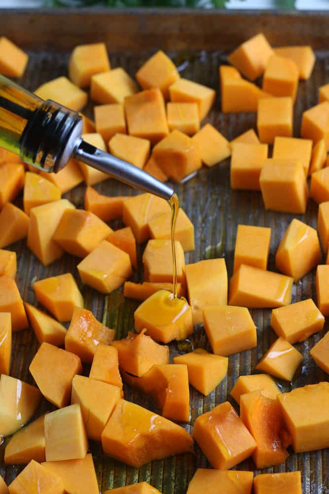 Pouring oil onto the squash