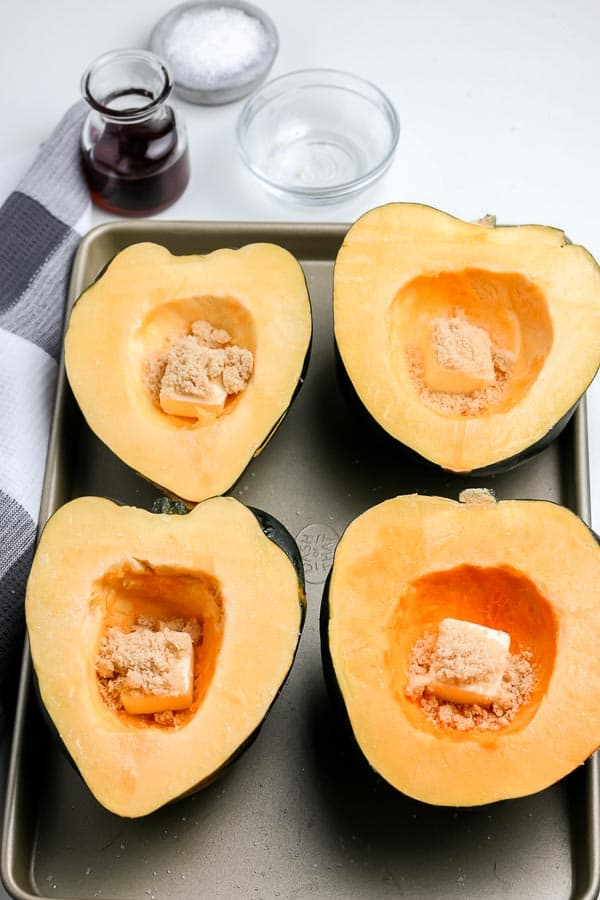 prepping acorn squash to cook