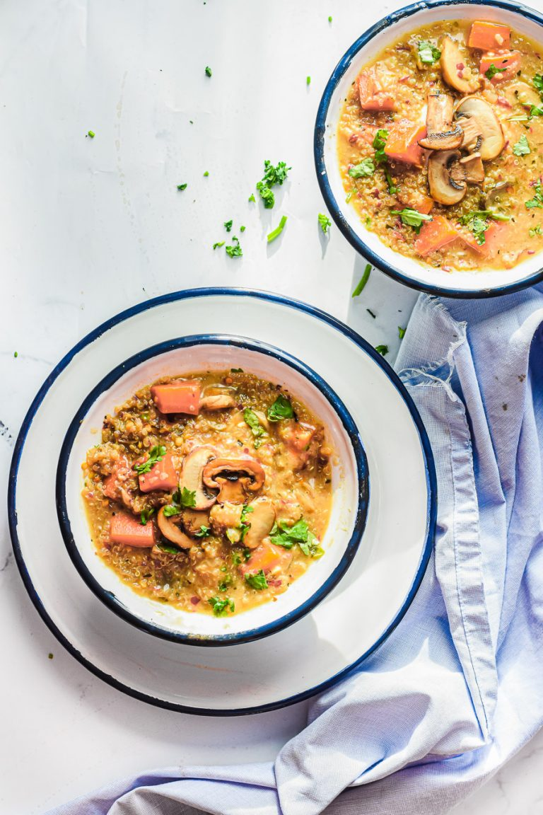 overhead view of two bowls of mushroom and quinoa soup