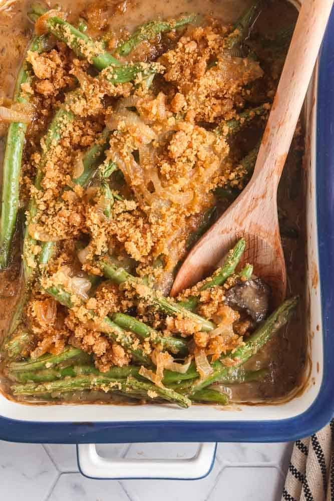 overhead view of a casserole dish of homemade green bean casserole with a spoon in it