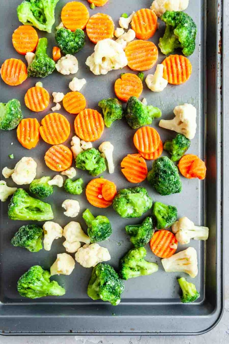 overhead view of frozen vegetables on a sheet pan
