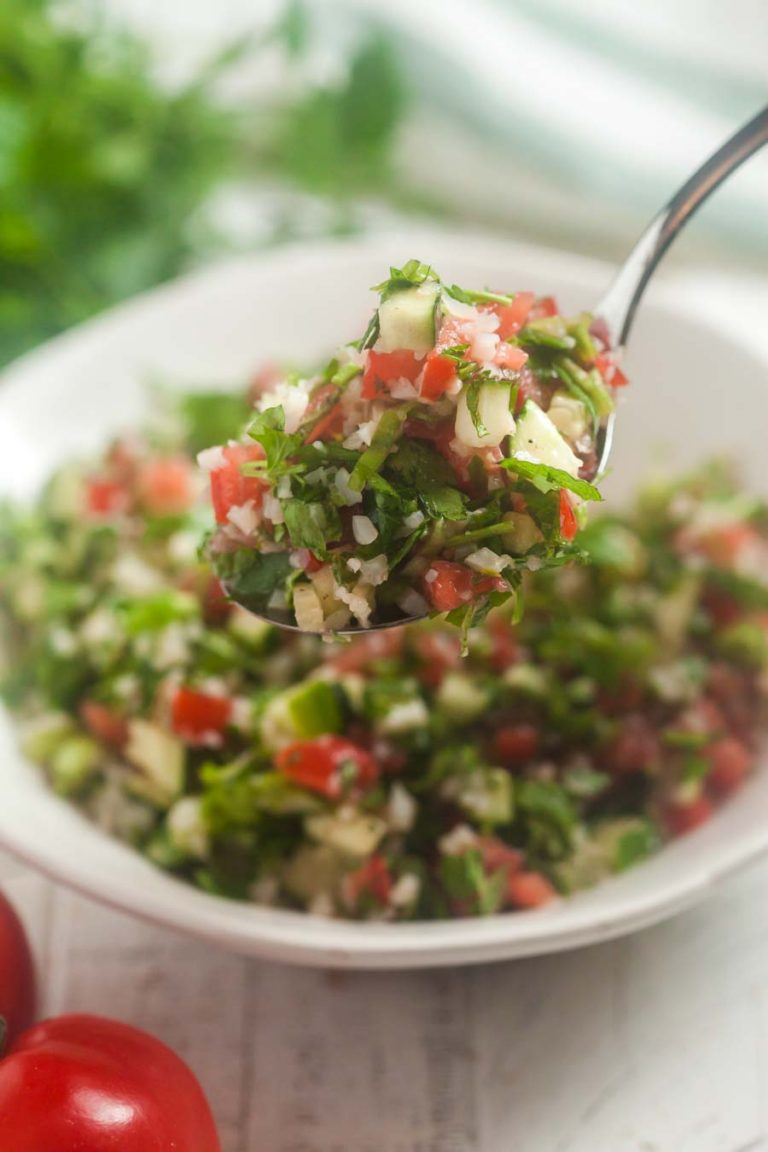 A spoonful of cauliflower tabbouleh.