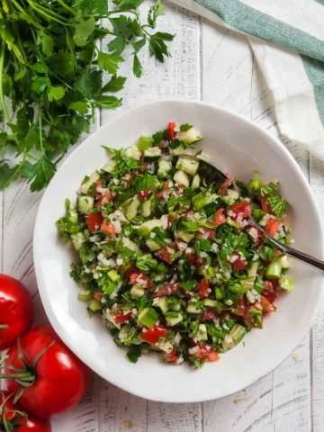 overhead view of tabbouleh salad in a white bowl.