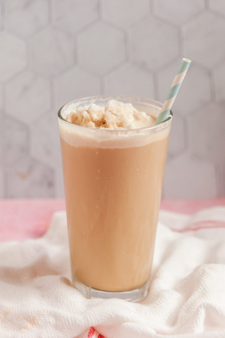 a glass of homemade frozen coffee with a blue and white striped straw