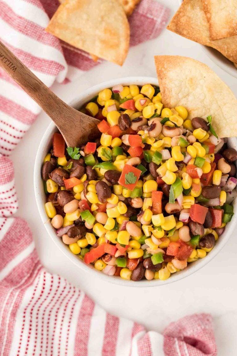 An overhead view of a serving bowl of bean and corn salsa (cowboy caviar)